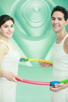 Man and woman standing together in a plastic hoop