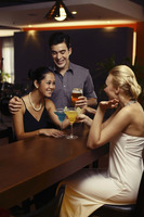 Man and women drinking at a bar