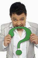 Man biting a question mark symbol