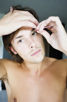 Man grooming his eyebrow