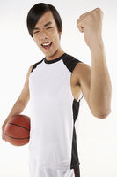 Man holding a basketball, cheering