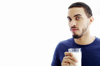 Man holding a glass of milk