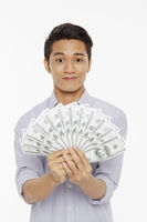 Man holding a pile of cash