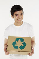 Man holding a recyclable cardboard box