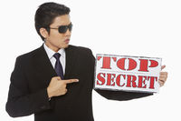 Man holding up a top secret
