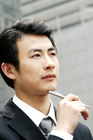 Man in business suit holding a pen