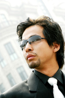Man in business suit wearing sunglass