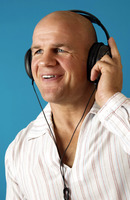 Man listening to music on his headphone