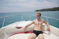 Man resting on speedboat