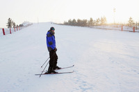Man skiing on winter day