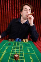 Man smoking cigar in casino