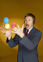 Man trying to juggle with three balls