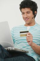 Man using laptop and credit card for home shopping