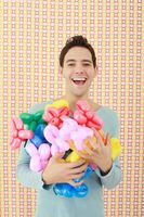 Man with an armful of sculpted balloons