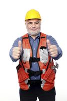 Man with hardhat showing thumbs up