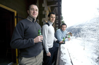 Men enjoying their drinks in the chalet