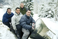 Men posing on snowmobile