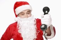 Santa claus holding a telephone receiver