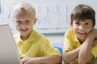 Schoolboys using a laptop