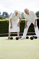 Senior couple lawn bowling in the bowling green