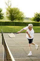 Senior man playing tennis in the tennis court