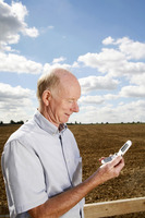 Senior man reading a message on his mobile phone