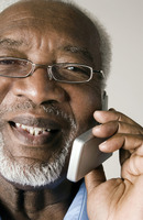 Senior man with glasses talking on the phone