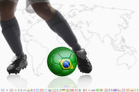 Soccer player dribble a soccer ball with brazil flag