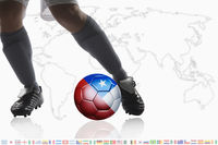Soccer player dribble a soccer ball with chile flag