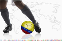 Soccer player dribble a soccer ball with colombia flag