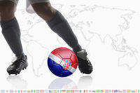 Soccer player dribble a soccer ball with croatia flag