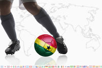 Soccer player dribble a soccer ball with ghana flag