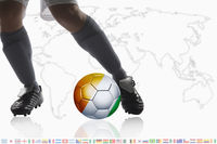 Soccer player dribble a soccer ball with ivory coast flag