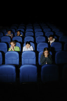Teenagers watching movie in cinema