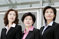 Three business women looking away