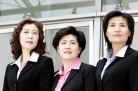 Three women in formal wear
