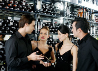Two couples choosing wine in the wine cellar