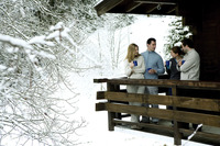 Two couples enjoying hot drinks in their chalet