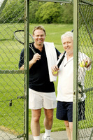 Two men with tennis racquet and tennis ball