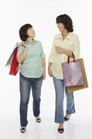 Two women carrying shopping bags