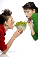 Two women eating salad