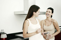 Two women hanging out in the kitchen