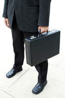 Waist down shot of a businessman carrying a briefcase