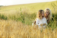 Woman and girl in a wheat field