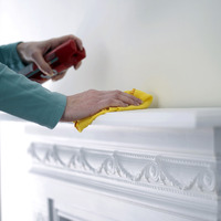 Woman cleaning the mantelpiece