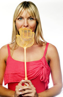 Woman covering her mouth with a fly swatter