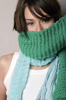 Woman covering her mouth with a scarf