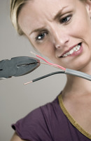 Woman cutting wire with pliers