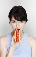 Woman eating hotdog