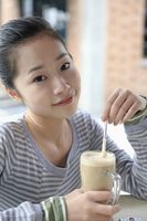 Woman enjoying a glass of latte